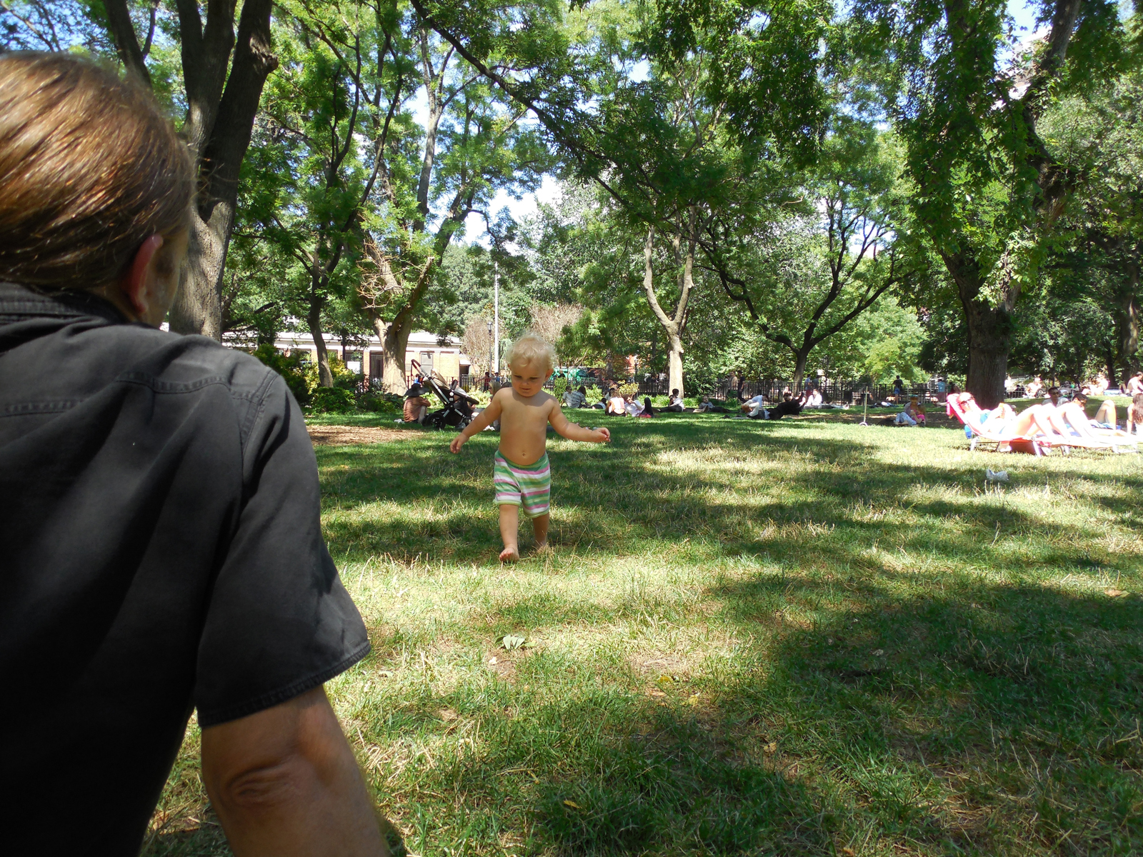 amelia walks across Tompkins Square july 2014